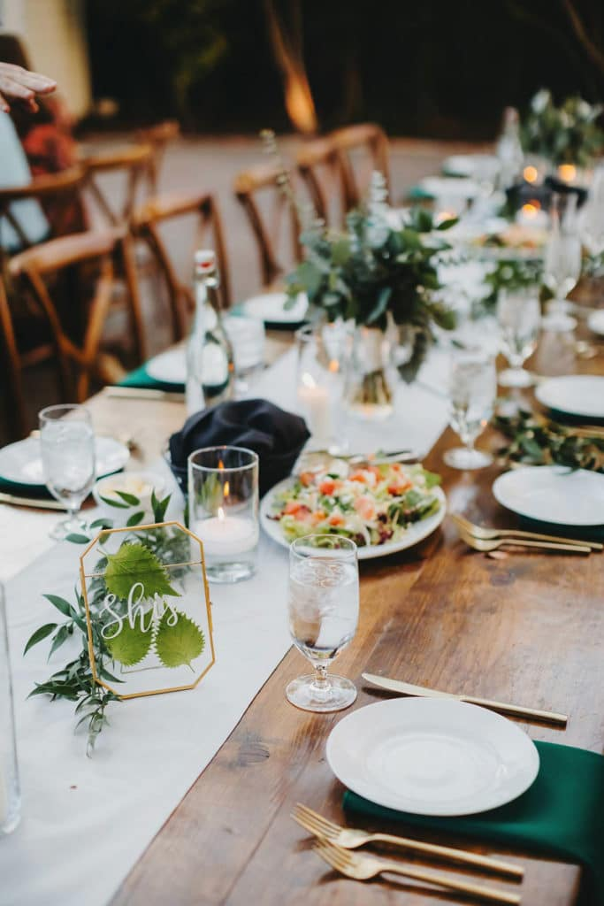 Family Style Meal Table Setting With Greenery